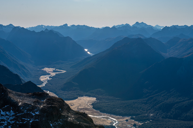 Eglinton River from Mount Eglinton. Mount Earnslaw / Pikirakatahi and Mount Aspiring / Tititea are on the skyline on the right. Knobs Flat is at the bottom edge.