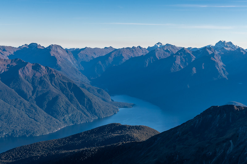 View from Mount Eglinton into the Worsley Arm of Lake Te Anau and Worsley Stream. Barrier Peak (right of centre) and Pariroa / Castle Mount (far right) are on the skyline.