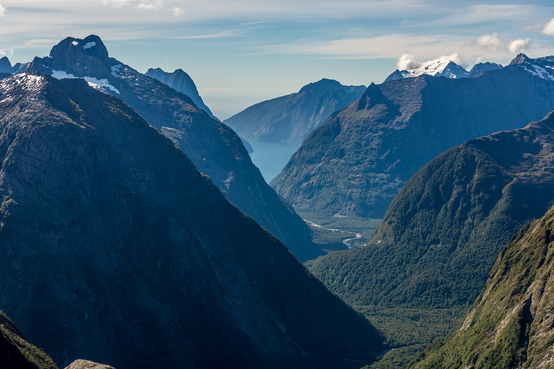 The Cleddau River and Milford Sound from Gertrude Saddle. The most prominent peaks from left to right are Sheerdown Peak, Mitre Peak and Mount Pembroke