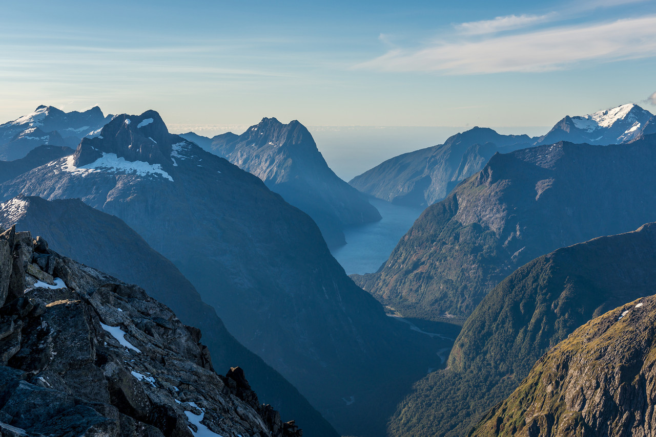 Milford Sound from Barrier Knob. From left to right are the Llawrenny Peaks (back), Sheerdown Peak (front), Mitre Peak (back), Mount Pembroke