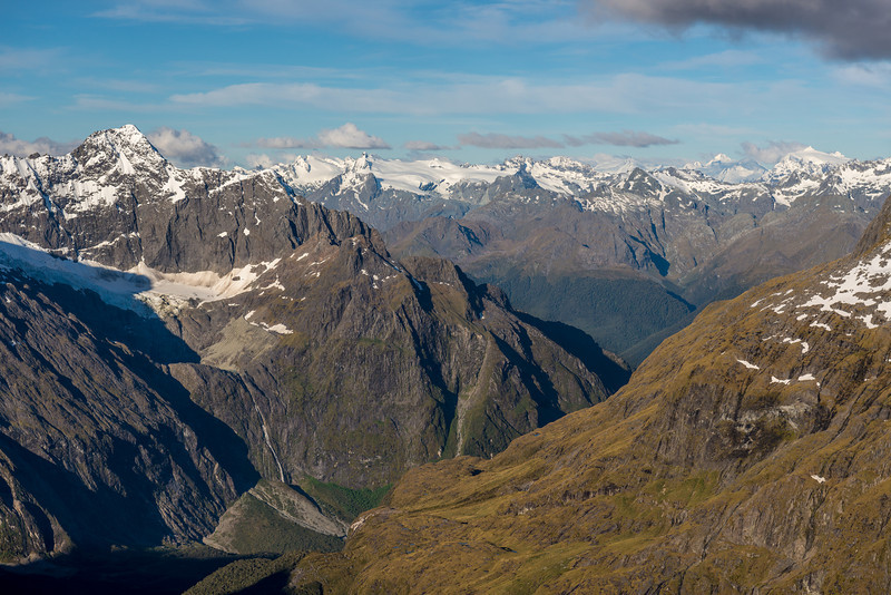 View from the summit of Barrier Knob: Mount Tuhawaiki and the waterfall draining the Korako Glacier are in the foreground on the left. In the background are the Park Pass Glacier, the Cosmos Peaks, Mts Lydia and Ian, Mount Aspiring, Mount Edward, Mount Head