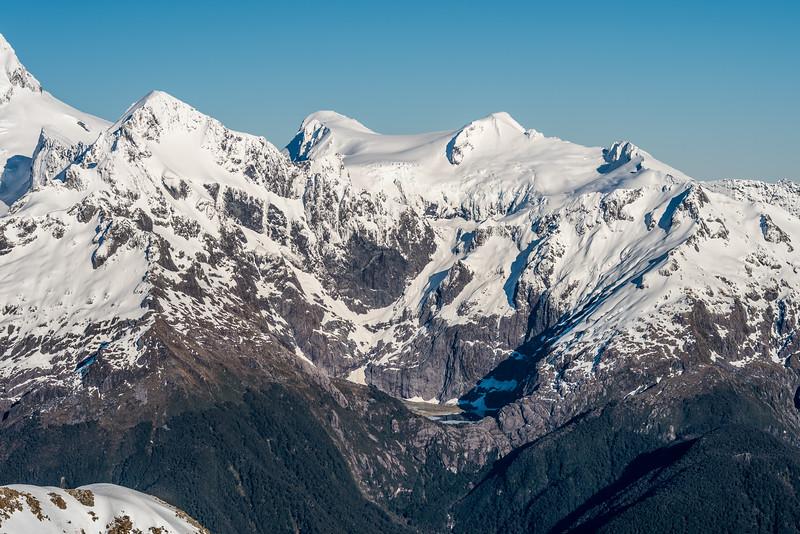Alice Peak, Paranui Peak, Ngapunatoru Plateau, Mount Parariki and Halfway Peak from Pt 1793m, Bryneira Range. Lake Agnes is at bottom centre image.