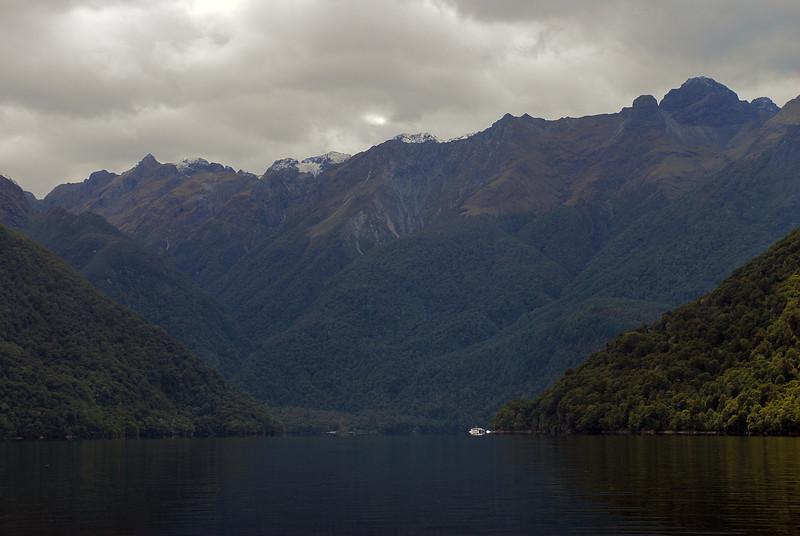 The Milford Track boat approaches Glade House, Lake Te Anau
