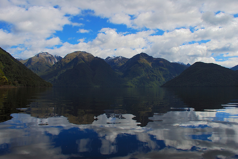 Calm morning on Lake Te Anau. Looking up into McQueen Creek (left), Indecision Creek (centre), Foliage Hill (right)