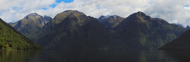 View up Lake Te Anau. McQueen Creek left, Indecision Creek at centre image