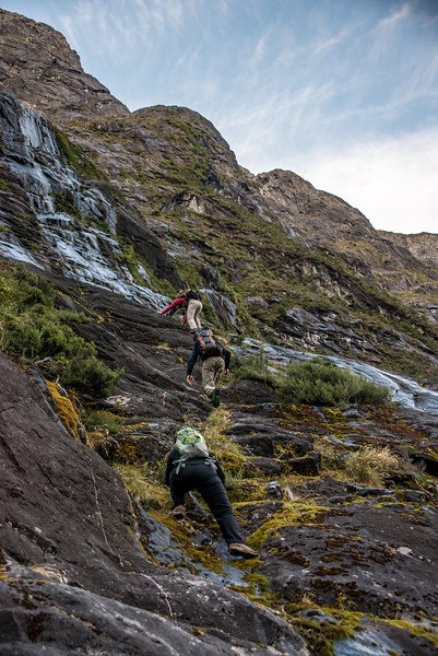 Climbing through the slabs above the Milford Road