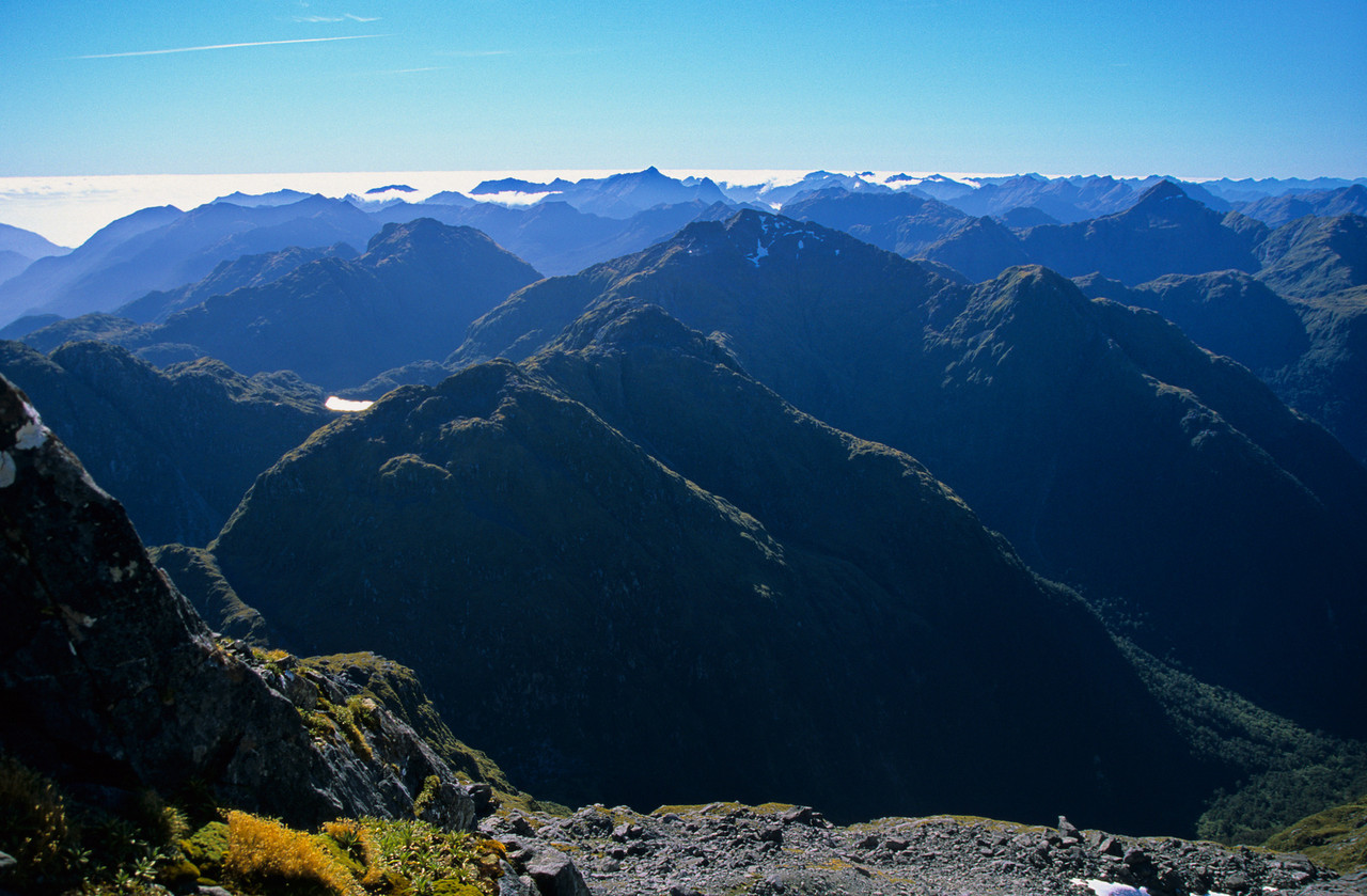 Looking north from Coronation Peak. Double Peak is at centre image, unnamed peak m1544 is the dark triangular mountain near the right edge.