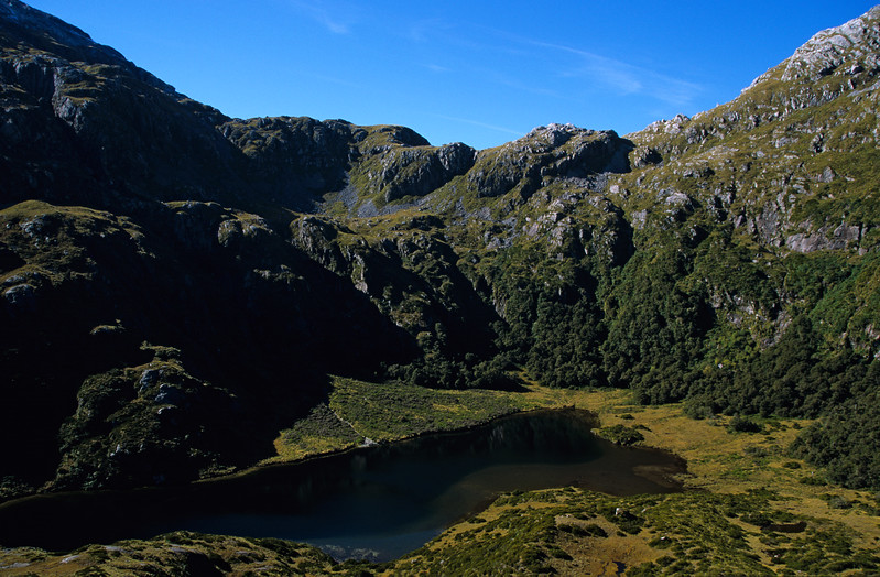 Robin Saddle from the west. The hut is just below the lake outlet, out of the image to the left