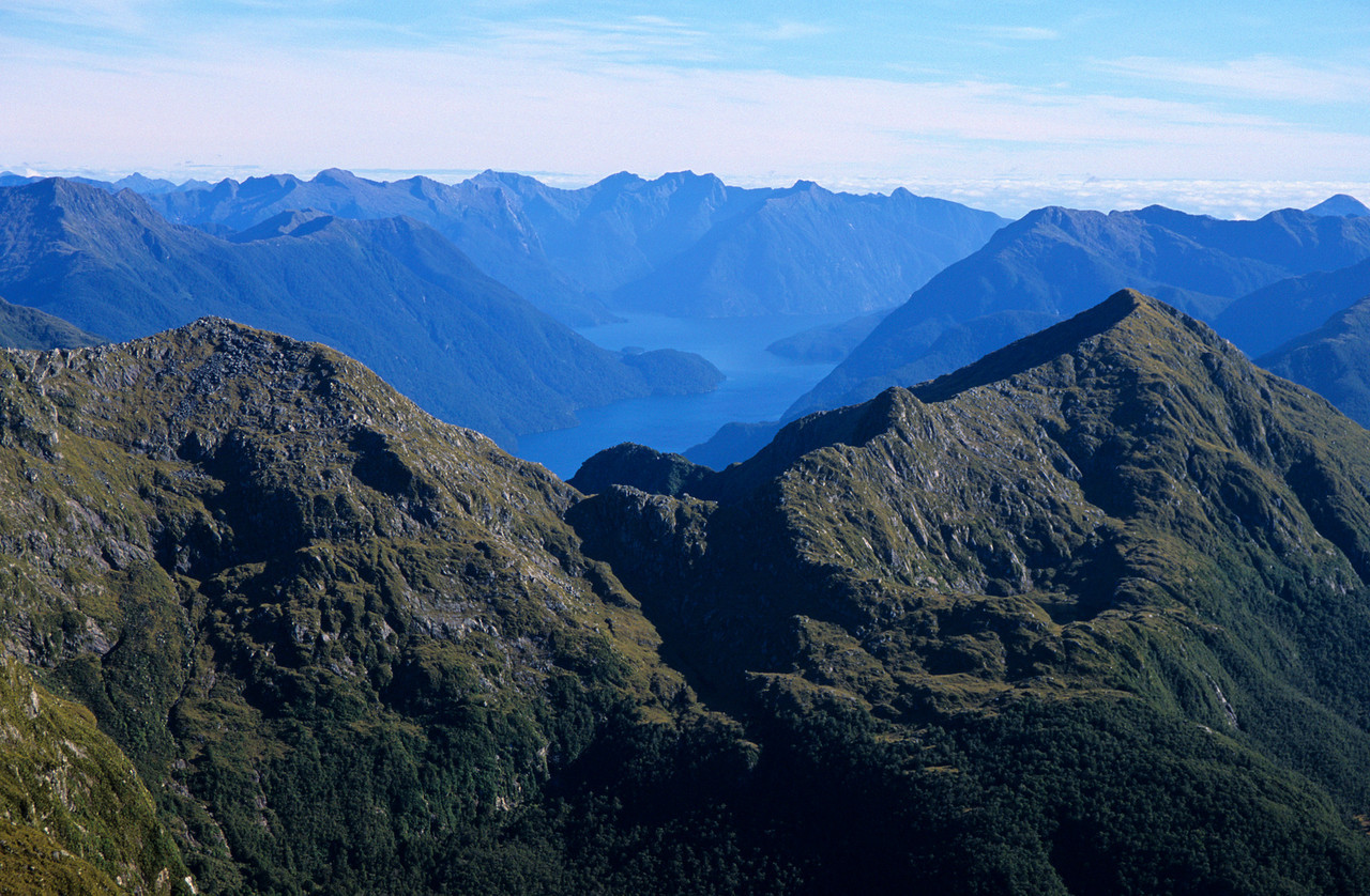 Looking south-west from up high on Coronation Peak. Precipice Cove in Bradshaw Sound at Centre image.
