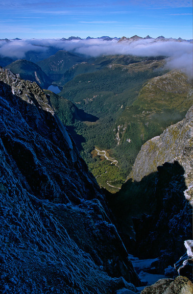 Looking down into the deep ravine separating unnamed peaks 1547m and 1526m south of Robin Saddle. Lake Te Au and Lake Hilda are visible in the background