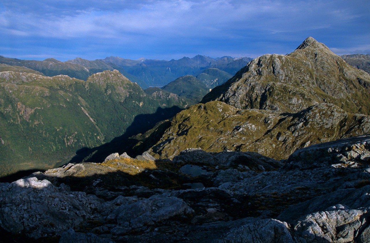 Looking south-east into the Murchison Mountains from peak m1302 above Robin Saddle. Unnamed peak m1474 to the right