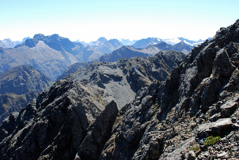 12. The Wick Mountains from the south ridge of Disappearing Peaks. In the centre foreground is the gendarme on the NW ridge that stopped our first attempt.