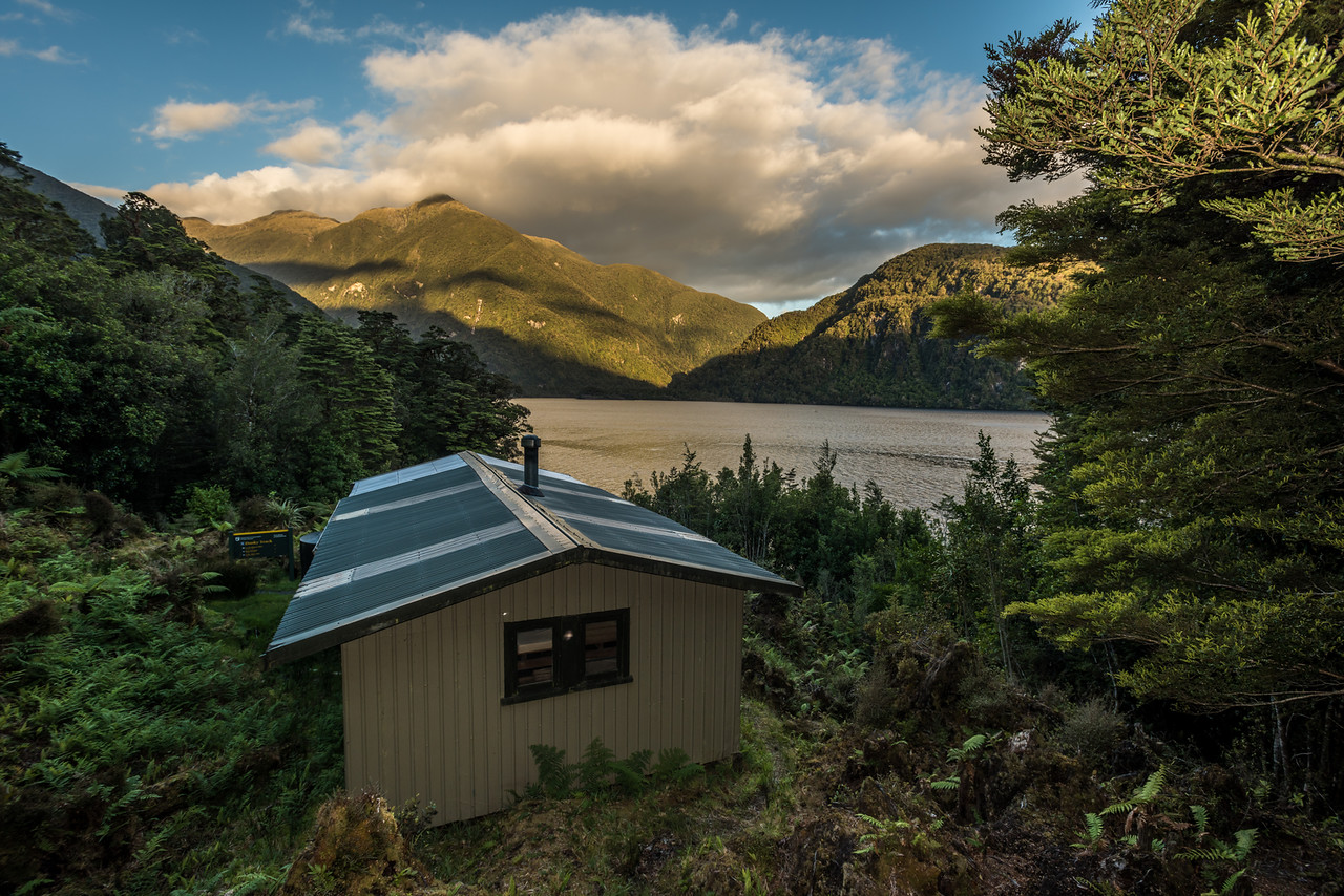Supper Cove Hut. Dusky Sound. Mount Vera is in the background.