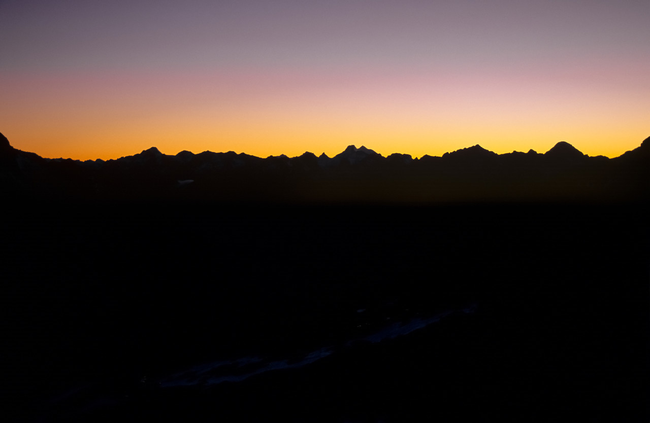 Dawn over the Forbes Mountains from the saddle between Falls Creek and Mistake Creek. Mount Earnslaw at centre image