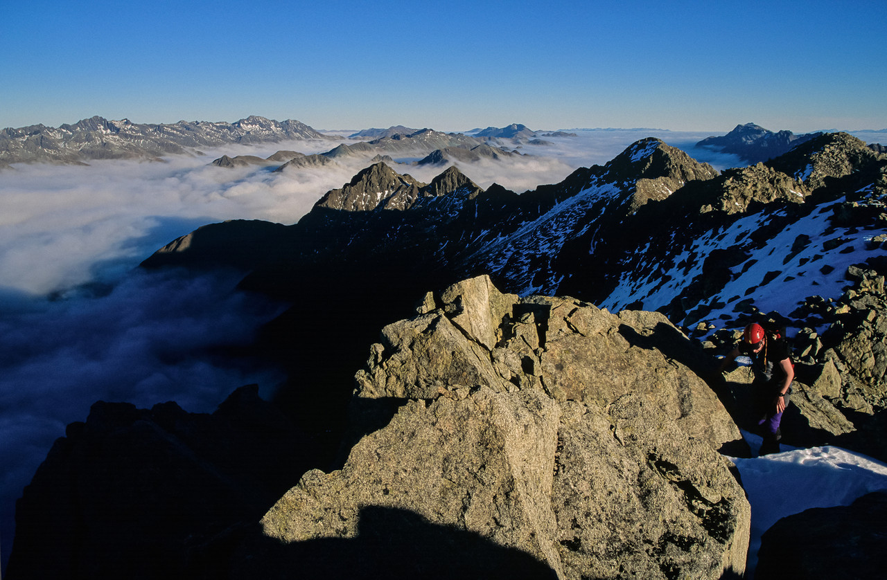 On the summit of Consolation Peak. Melita Peak is at centre image; the Livingstone Mountains back left