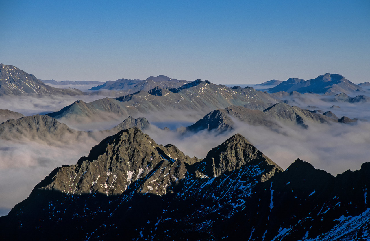 View of Melita Peak (in the foreground) from Consolation Peak. The Livingstone Mountains and the Countess Range in the back