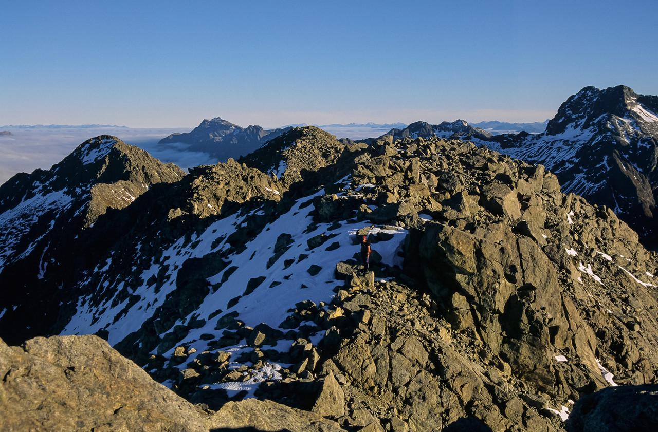 On the summit of Consolation Peak. Triangle Peak on far right