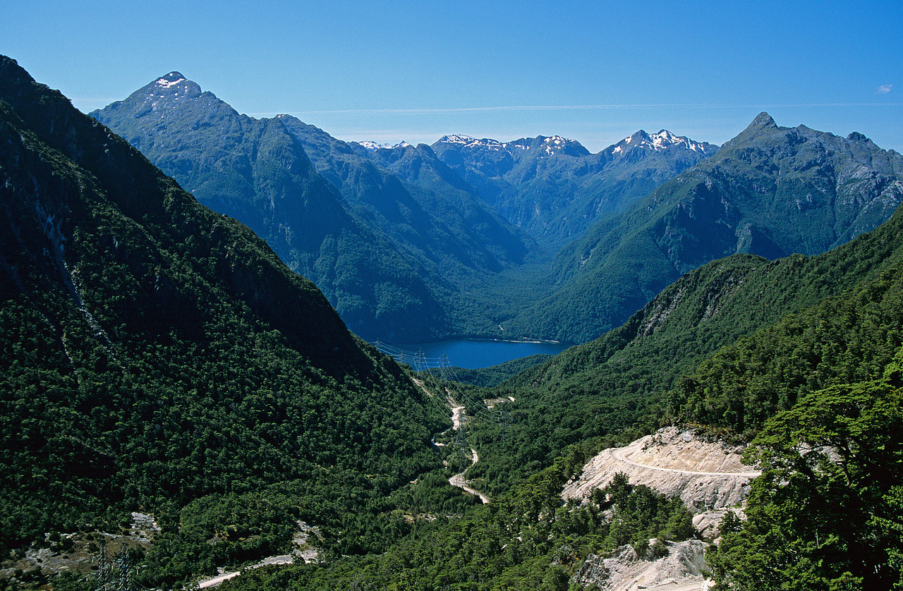 View of Lake Manapouri West Arm from the road below Percy Saddle. Leaning Peak (left) and Steep Peak (right) are either side of the Oonah Burn.