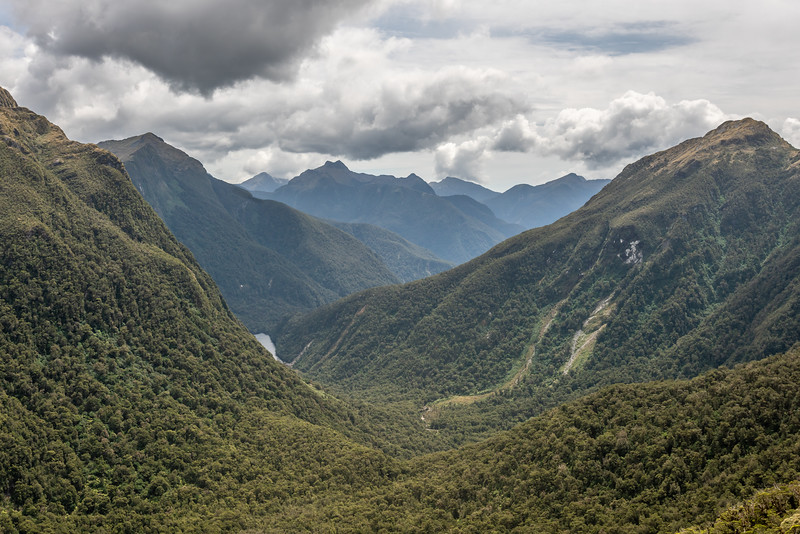 Looking down Katherine Creek from Henry Pass. Saddle Hill is directly behind (and above) Lake Katherine. Nita Peak is on the far right. George Sound Route, Fiordland National Park.