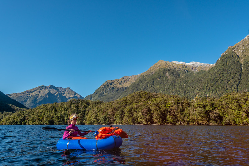 Pack rafting Lake Hankinson. The Stuart Mountains above.