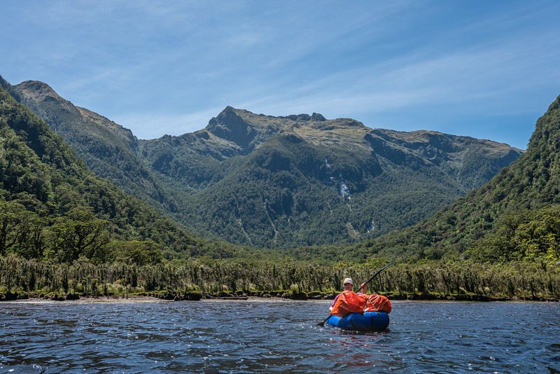 Pack-rafting Lake Katherine. Mount Henry is in the background. George Sound Route, Fiordland National Park.