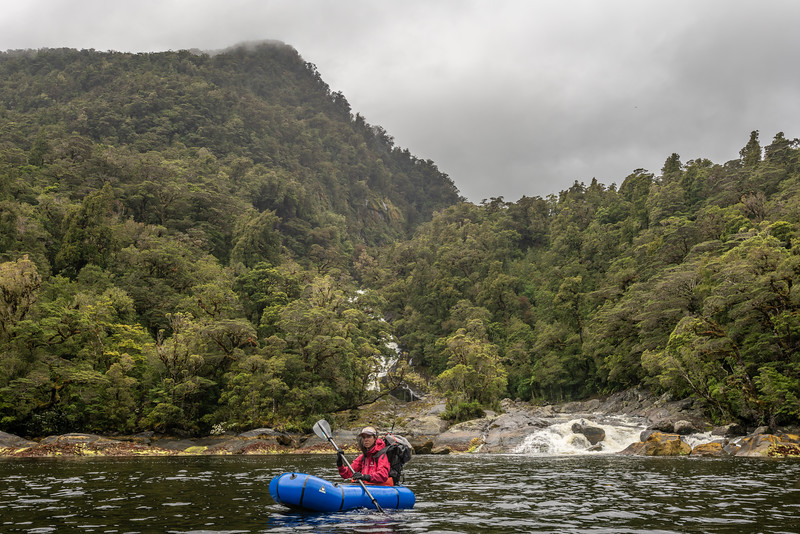Pack-rafting near Alice Falls on George Sound. Fiordland National Park.