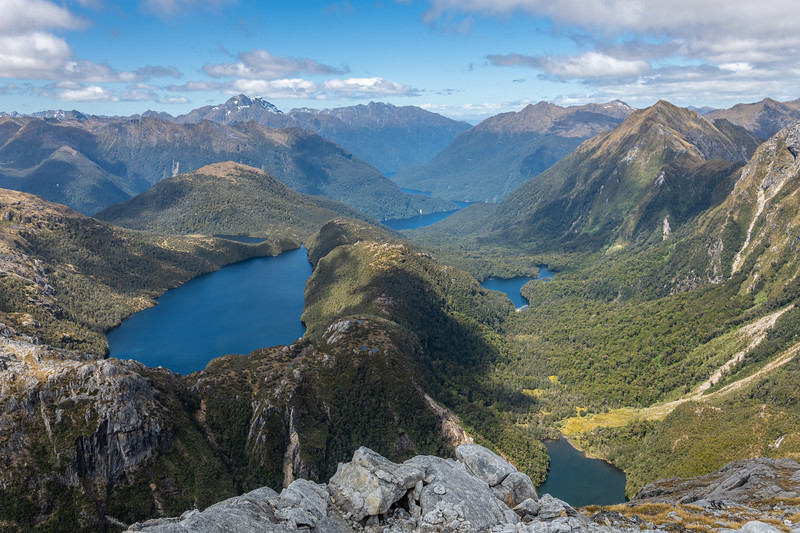 View down the Gorge Burn from the east ridge of Mount Baird. Lake Boomerang is at the bottom edge of the image. Lake Cecil is further down valley, and Lake Hall up high on the left. Mount Lyall is left of centre image. Mount Martin on the far right.