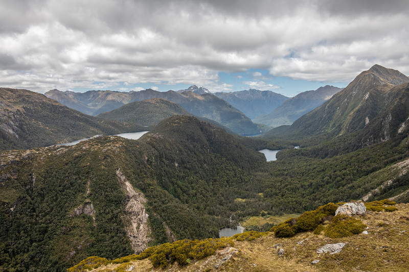 View down the Gorge Burn from the east ridge of Mount Baird. The outlet of Lake Boomerang is just visible near the bottom edge of the image. Lake Cecil is further down valley, and Lake Hall up high on the left. Mount Lyall is at centre image. Mount Martin on the far right.