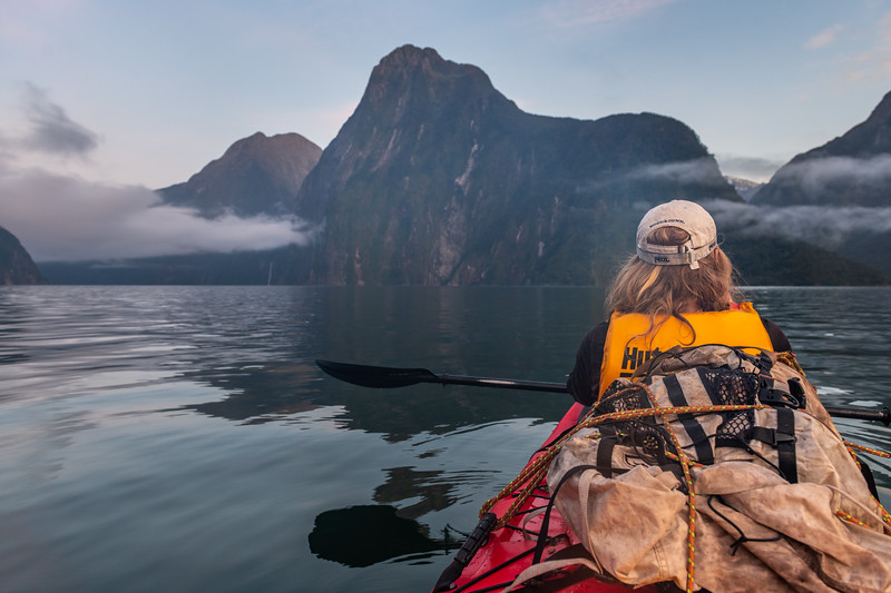 Early morning kayaking in front of the Lion, Milford Sound.