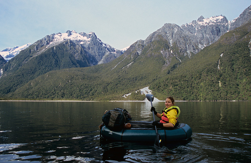 Paddling Lake McKerrow. Puketuroto Peak and Mount Thunder above