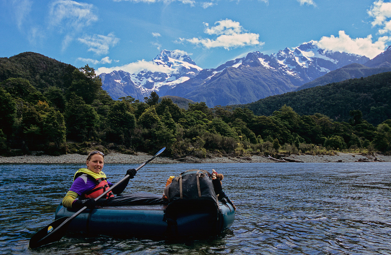 Paddling the Hollyford River. Mt Madeline and Alice Peak in the background