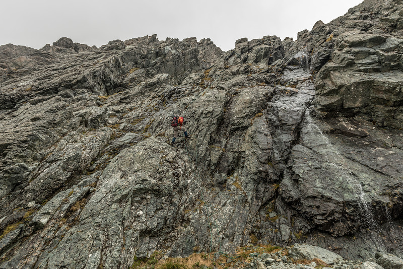 Abseiling off the west ridge of Jean Batten Peak in foul weather