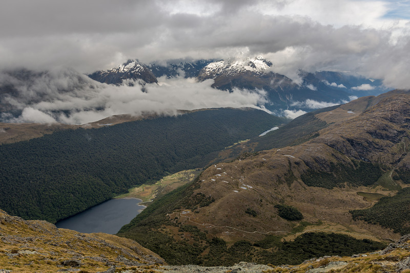 View of McKellar Saddle from the west ridge of Jean Batten Peak. Lake McKellar, Lake Howden and the Greenstone River on left