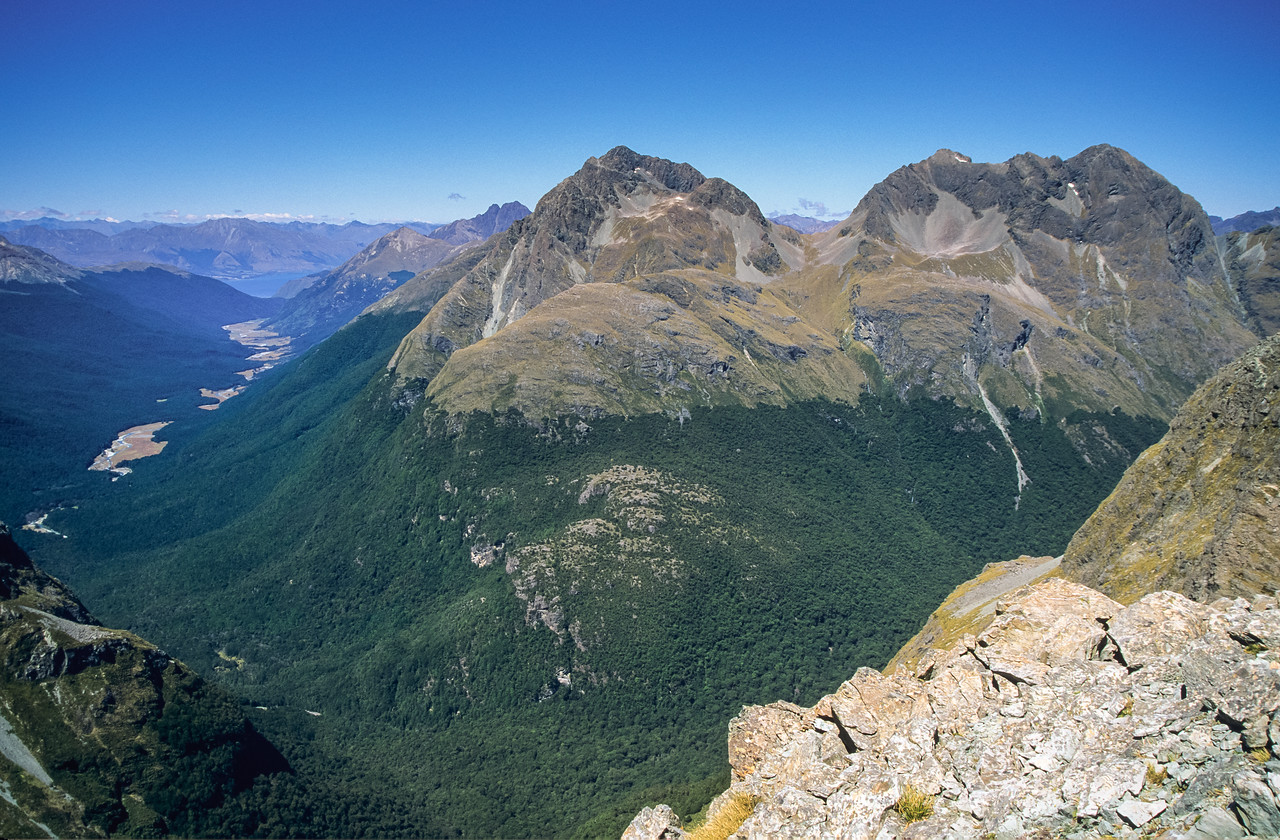 View down the Caples River to Lake Wakatipu from Unnamed Peak 1695m, Ailsa Mountains. Pt 2024m is at centre image; Tooth Peak just behind and left of it, while Jean Batten Peak is on the far right
