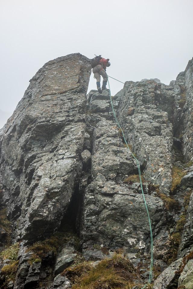 Abseiling off the west ridge of Jean Batten Peak in foul weather