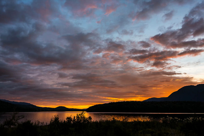 Time lapse - Sunrise at Rodger Inlet Hut, Lake Monowai. The dark spots that randomly appear in the image are sandflies!