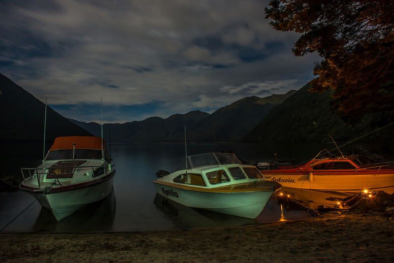 Painting with light: tea party candles illuminate the boat to the right; an LED torch the other two boats. At the top of Lake Monowai