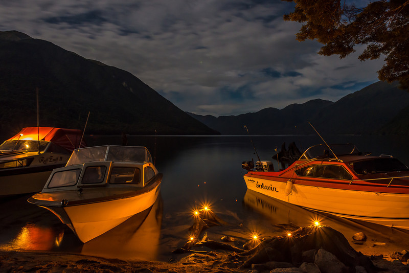 At the top of Lake Monowai. Floating tea party candles are used to illuminate the boats