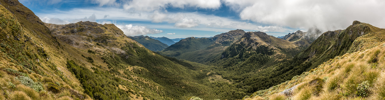 View down the Jeanie Burn from the south ridge of Rugged Mount, Cameron Mountains. Cunaris Sound is visible in the back, and a small speck of Long Sound in front. The saddle into the Richard Burn is on the far right.