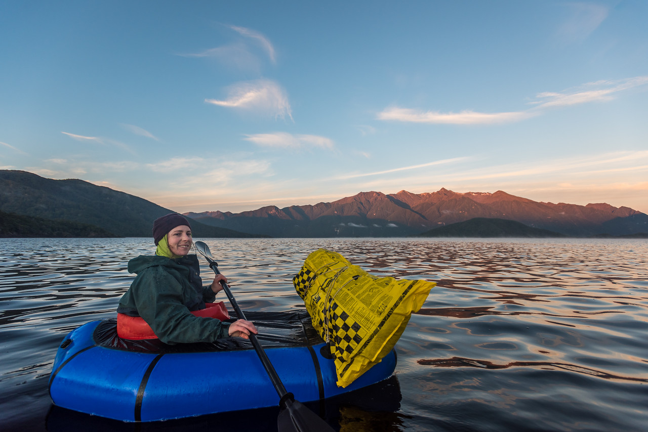 Paddling Lake Hauroko at dawn. The Princess Mountains are in the background.