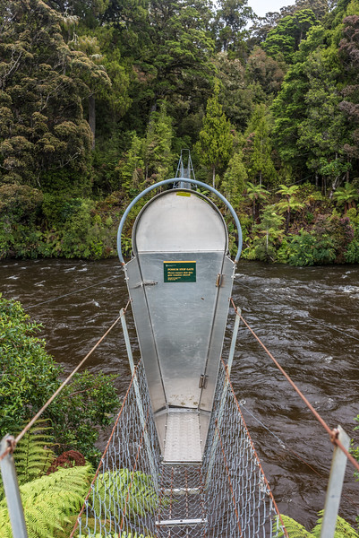 Possum stop gate on the Wairaurahiri River swingbridge.
