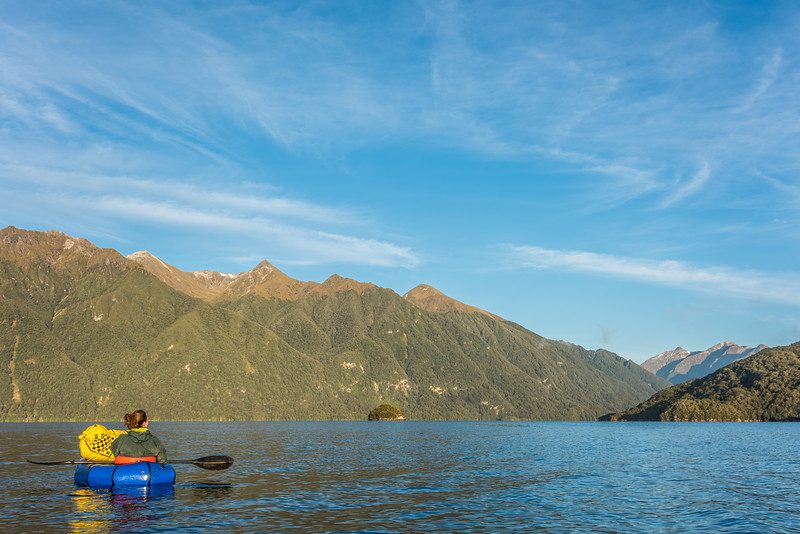 Paddling Lake Hauroko. The Princess Mountains are in the background.
