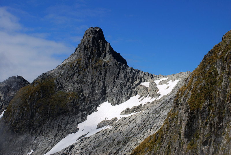 The southern Nicholas Peak (1792m) from the south ridge of Aiguille Rouge. Our route crosses the saddle to the right