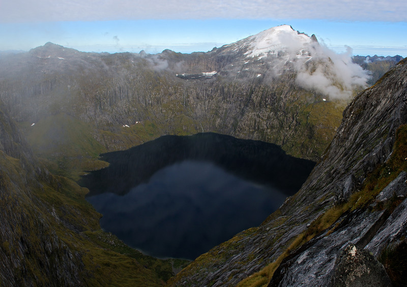 Lake Quill from the south ridge of Aiguille Rouge. Couloir Peak (left) and unnamed peak 1885m (right) above