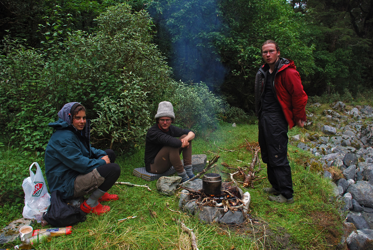 Cooking on the fire in the Nicholas Cirque, waiting for the weather to clear.