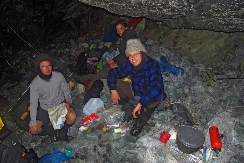 An overhang gave us providential shelter for a dry lunch in a flooded Staircase Creek