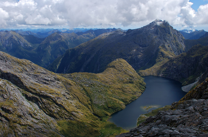 View into the head of the Dark River from unnamed peak 1653m above Lake Quill. Near the right edge of the image are Light - Dark Saddle and unnamed peak 1682m above. The hanging valley of Robb Creek is on the left.
