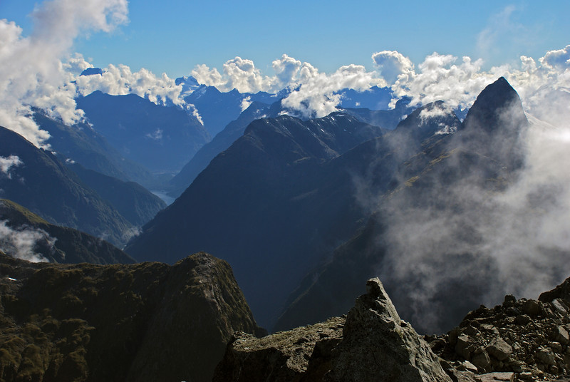 Looking down the Arthur River into Milford Sound from unnamed peak 1885m. Mt Tutoko and Mt Madeline are visible on the horizon; Mt Elliot stands out near the right edge of the picture.