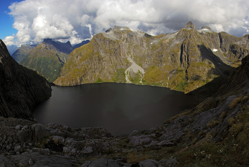 Lake Quill from the outlet of the unnamed lake above. Aiguille Rouge and the Nicholas Peaks in the background.