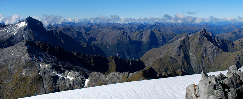 Panorama from unnamed peak 1885m. Barrier Peak to the left; Light - Dark Saddle and unnamed peak 1682m to the right.